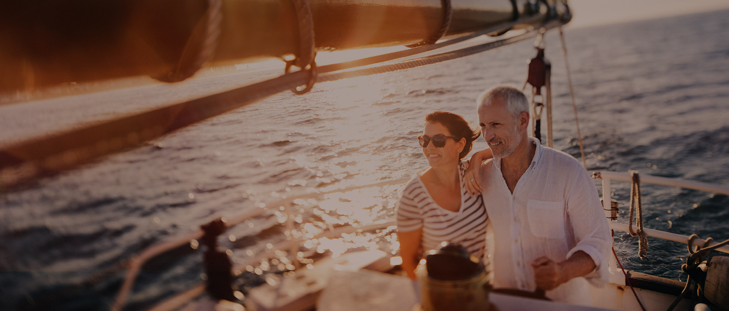 couple on boat who are carefree because they used elite client insurance services