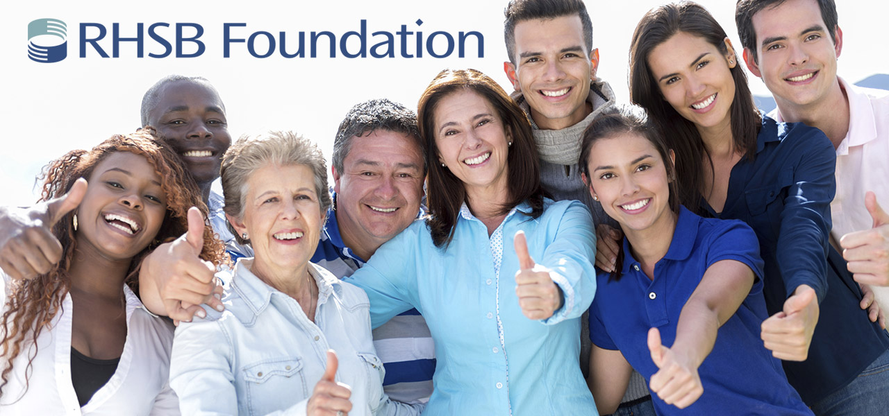 group of happy people with RHSB foundation logo
