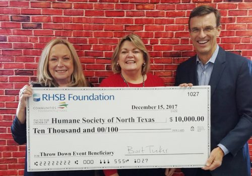 Karen Farris and Bart Tucker present $10,000 check to Humane Society of North Texas