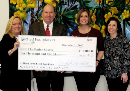 Karen Farris and John Hall present $10,000 check to The Senior Source