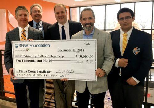 Tom Hughston and John Losurdo present $10,000 check to Cristo Rey Dallas College Prep