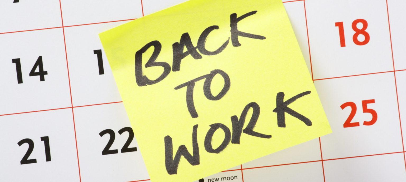 back to work sticky note on calendar